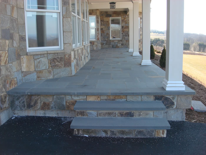 Patios that are designed to add to your outdoor living space for Bluestone front porch
